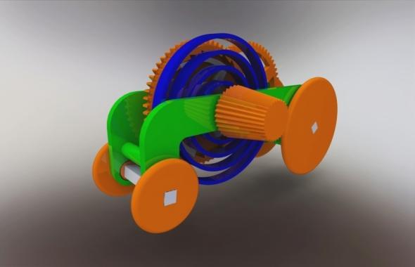 Úkolem soutěže bylo navrhnout spirálovou pružinu v SOLIDWORKSu, která poslouží jako pohon traktůrku.
