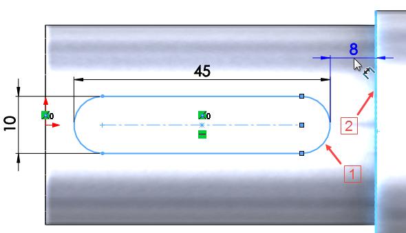 Dvojklikem edituje kótu šířky drážky a přepište hodnotu na 10 mm. Délka drážky se volí podle normalizovaných délek per. Editujte kótu délky drážky a úměrně kdélce čepu hřídele změňte hodnotu na 45 mm. Zakótujte vzdálenost oblouku drážky od hrany čepu 8 mm